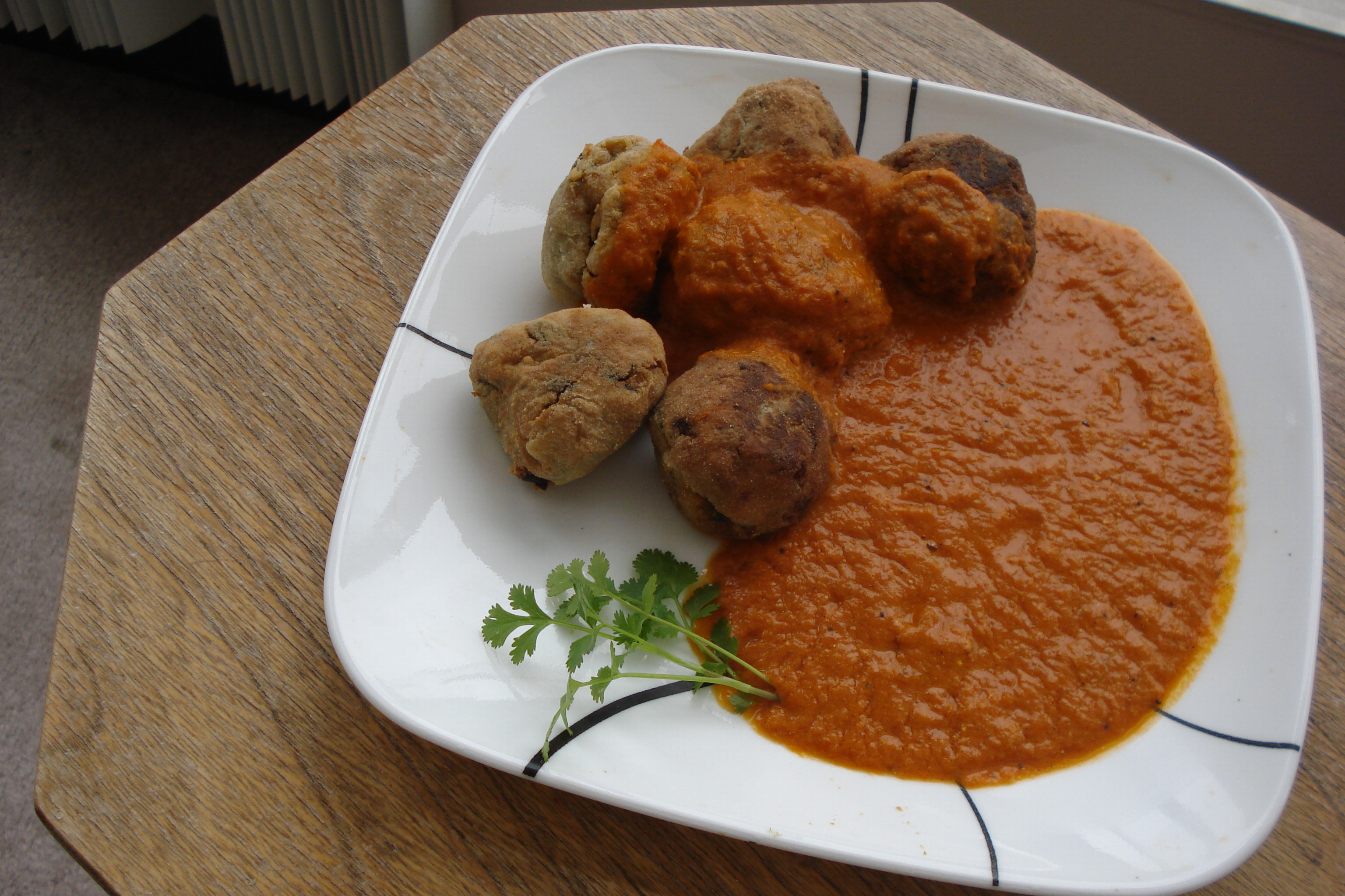 ... add the fried koftas and here are my fried koftas yam koftas are ready